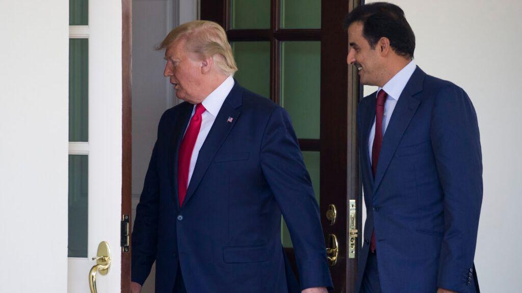 President Donald J. Trump heads inside followed by Qatari Emir Tamim bin Hamad al-Thani upon his arrival at the White House, July 9, 2019, in Washington. (AP Photo/Alex Brandon)