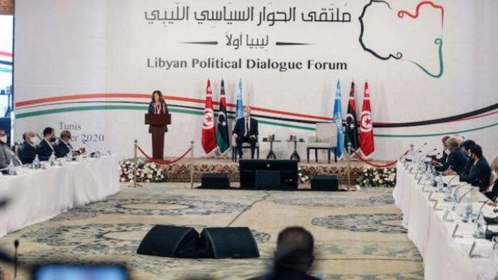 Acting Special Representative of the Secretary General for Libya Stephanie Williams, left, and Tunisian President Kais Saied attend the opening ceremony of the Libya's peace talks in Tunis, Tunisia, Nov. 9. (AP Photo/Hassene Dridi)