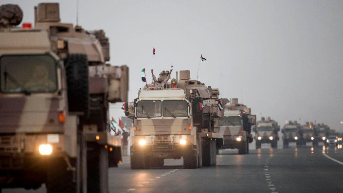 A convoy of UAE military vehicles and personnel travels from Al Hamra Military Base to Zayed Military City, marking the return of the first batch of UAE Armed Forces military personnel from Yemen, in Abu Dhabi, United Arab Emirates, Nov. 7, 2015. (Ryan Carter, Crown Prince Court – Abu Dhabi/WAM via AP)