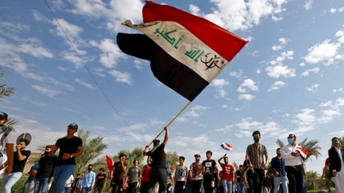Iraqi demonstrators gather to mark the first anniversary of anti-government protests in Najaf, Iraq, October 25, 2020. (REUTERS/Alaa Al-Marjani)