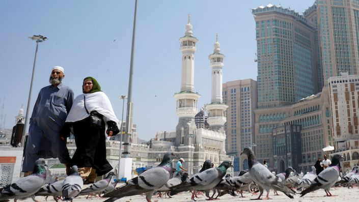 Worshippers walk past pigeons after the noon prayers outside the Grand Mosque, Mecca, Saudi Arabia, March 7. (AP Photo/Amr Nabil)