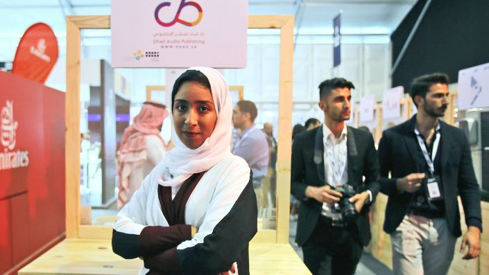 Saudi entrepreneur, Manar Alomayri, a partner of Dhad Audio Publishing, poses for the camera in front of her stand at the Digital Media Services tent as a part of the Step 2017 Conference and Music in Dubai, United Arab Emirates, April 5, 2017. (AP Photo/Kamran Jebreili)