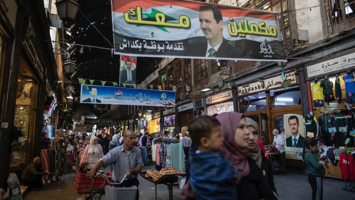 Posters Syrian President Bashar al-Assad hang in the Hamadiyah market in the Old City of Damascus, Syria, May 24. (AP Photo/Hassan Ammar)