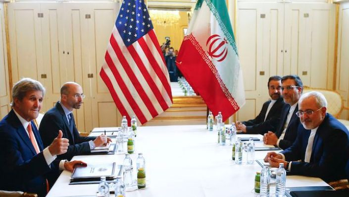 Then-U.S. Secretary of State John Kerry, left, and Iranian Foreign Minister Mohammad Javad Zarif attend a bilateral meeting in Vienna, Austria, May 17, 2016. (Leonhard Foeger via AP)