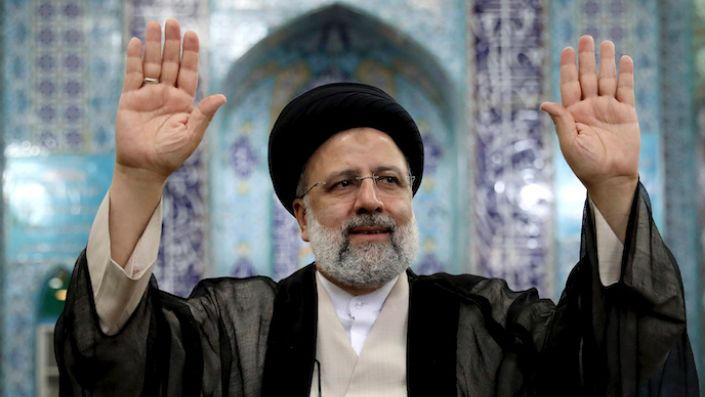 Iranian presidential candidate Ebrahim Raisi waves to the media after casting his vote at a polling station in Tehran, Iran, June 18. (AP Photo/Ebrahim Noroozi)
