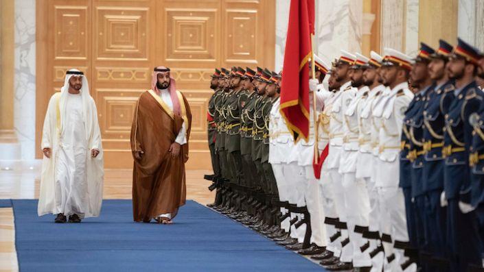 Saudi Crown Prince Mohammed bin Salman, right, inspects the honor guard next to Abu Dhabi Crown Prince Mohammed bin Zayed al-Nahyan in Abu Dhabi, United Arab Emirates, Nov. 27, 2019. (Rashed Al Mansoori/Ministry of Presidential Affairs via AP)