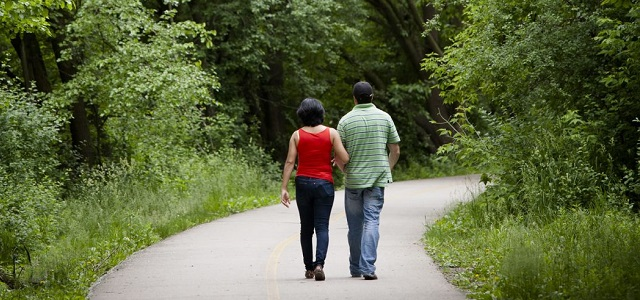 Two people walking on a trail