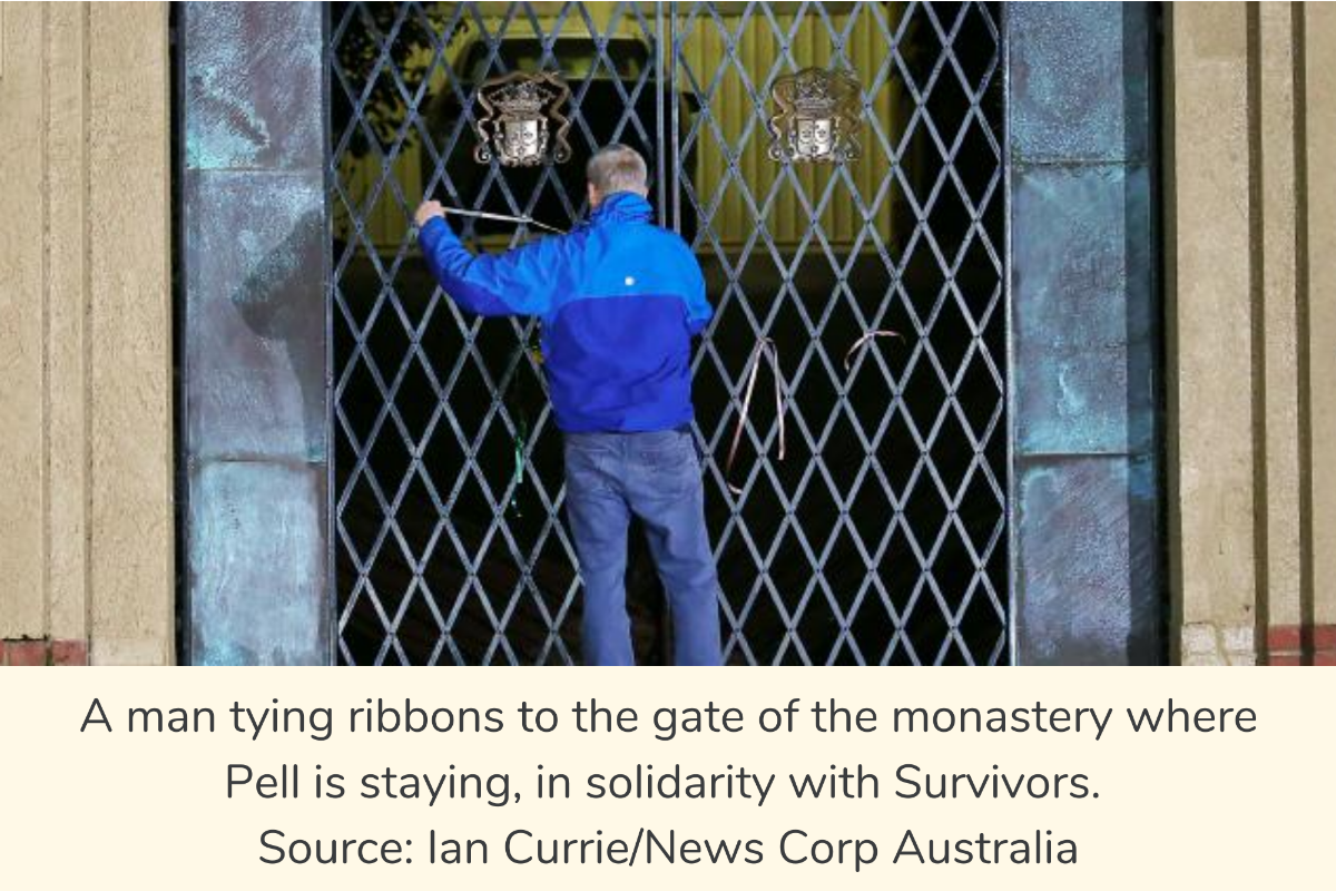 A man tying ribbons to the gate of the monastery where Pell is staying, in solidarity with Survivors. Source: Ian Currie/News Corp Australia