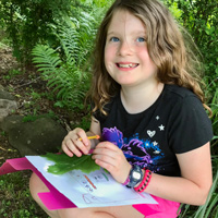 Girl with nature journal