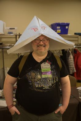Foolscap Captain Douglas Beal in Folded Paper Boat Hat with Eyes