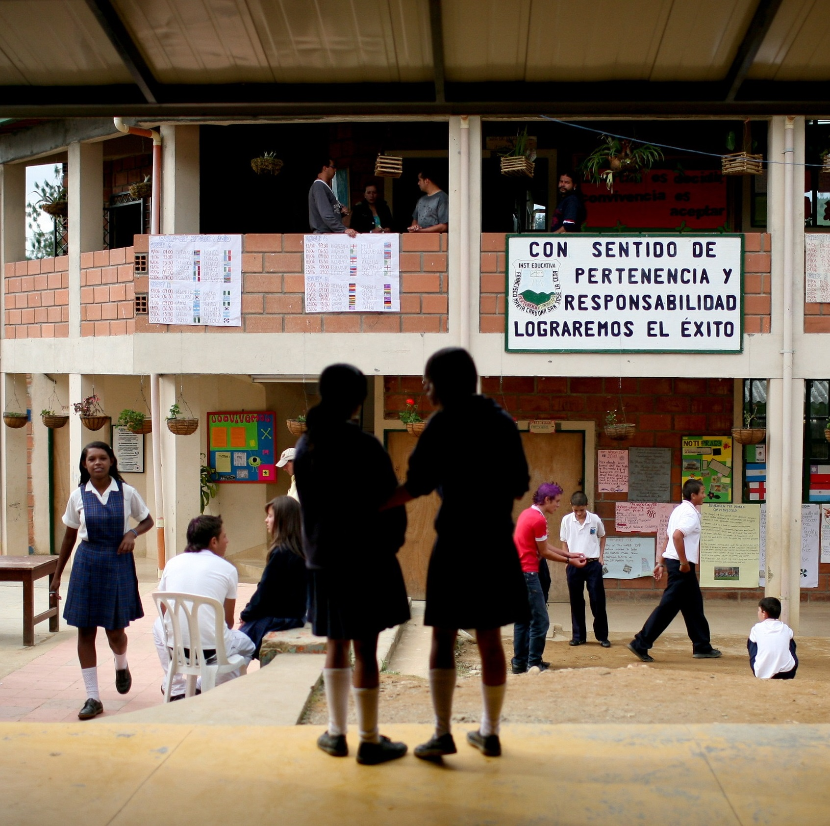 Pupils talking and walking in a school yard in a school in Colombia