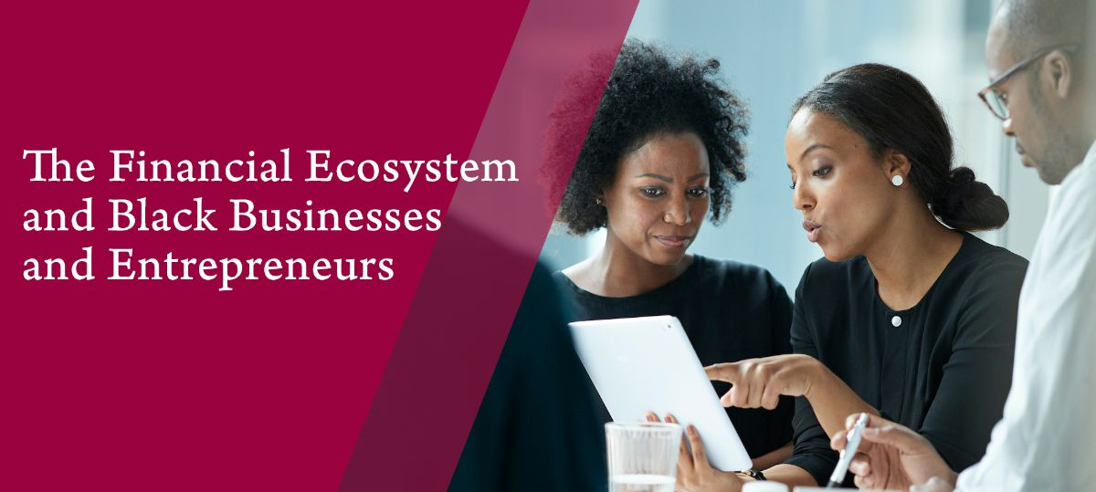 The Financial Ecosystem and Black Businesses and Entrepreneurs (Image: two Black women and a Black man in discussion over an ipad