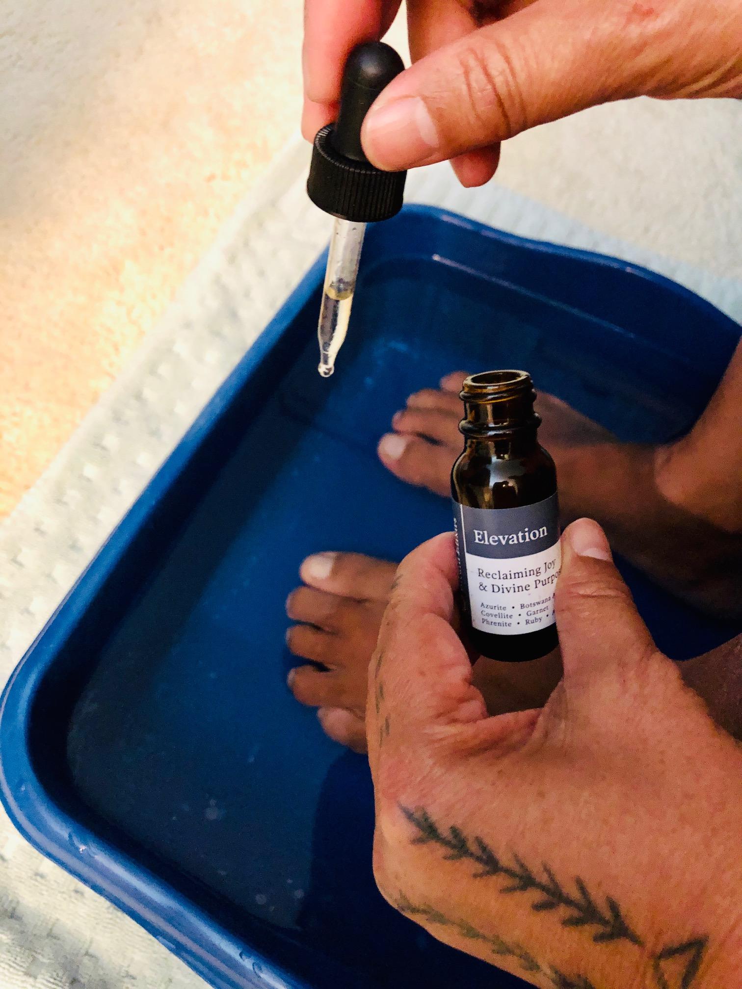 Dr. Chris Lipat takes an epsom salt foot bath with a drop of Bituin Elixir Flower Essence and Gem Elixir Blend