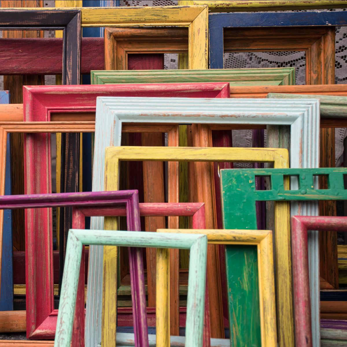 a colourful group of empty picture frames