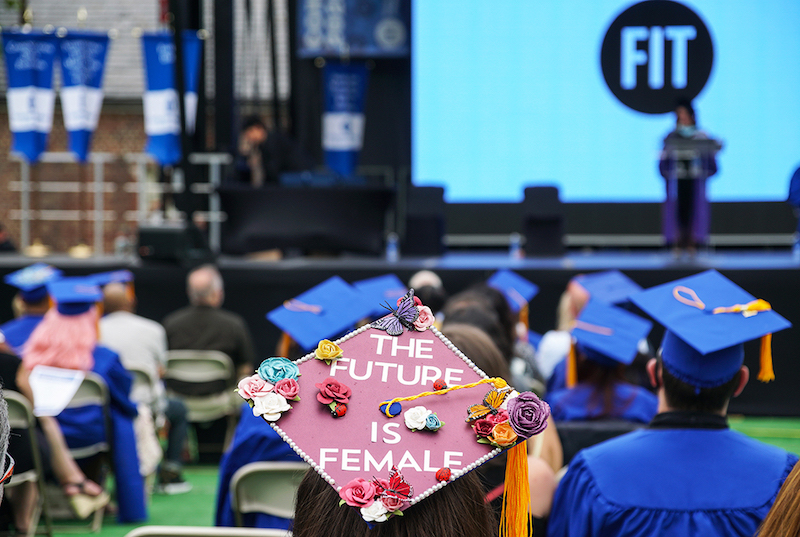 students with mortarboards at FIT commencement