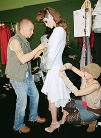Alexander McQueen dressing models at a runway show
