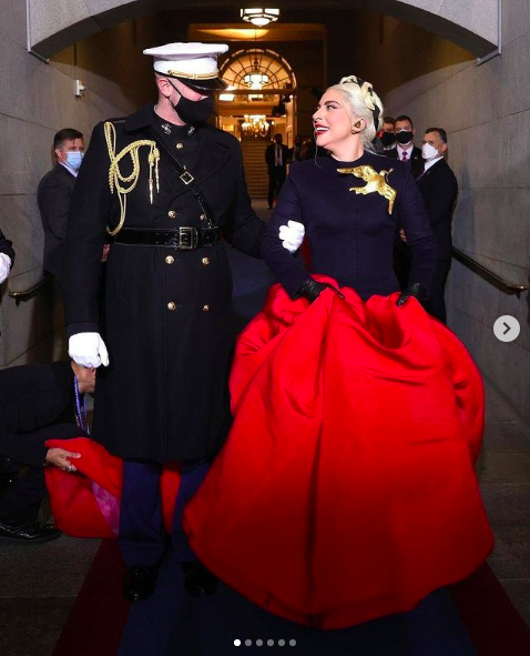 Lady Gaga walking with officer at the Presidential Inauguration