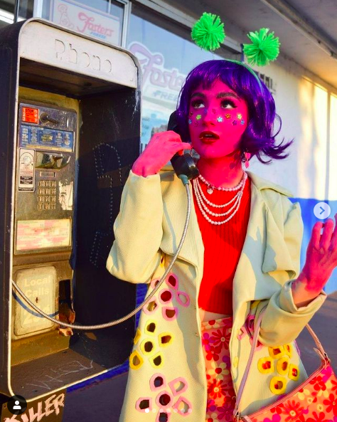 image by Luna Legaspi of a woman at a phone booth wearing Luna's final fashion project