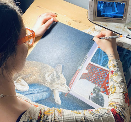 Ryann Alaimo at work illustrating a picture