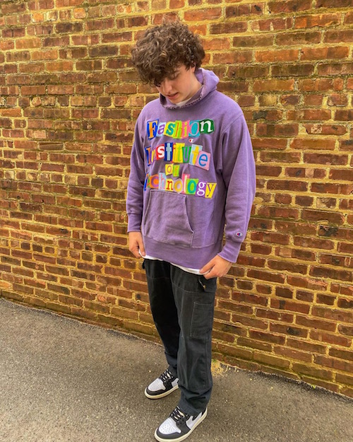 student with homemade Fashion Institute of Technology hoodie
