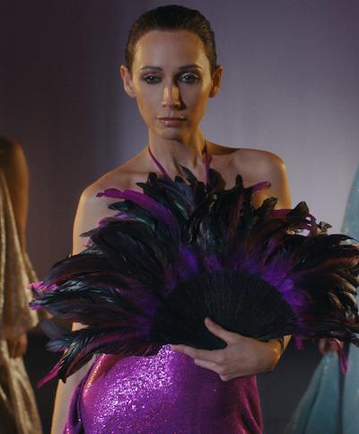 model wearing purple Halston dress in Netflix's Halston