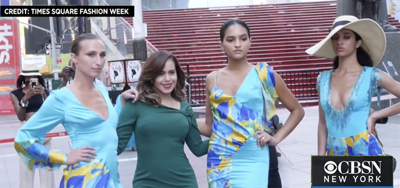 Cenia Paredes standing among models wearing her garments, CBS2 logo