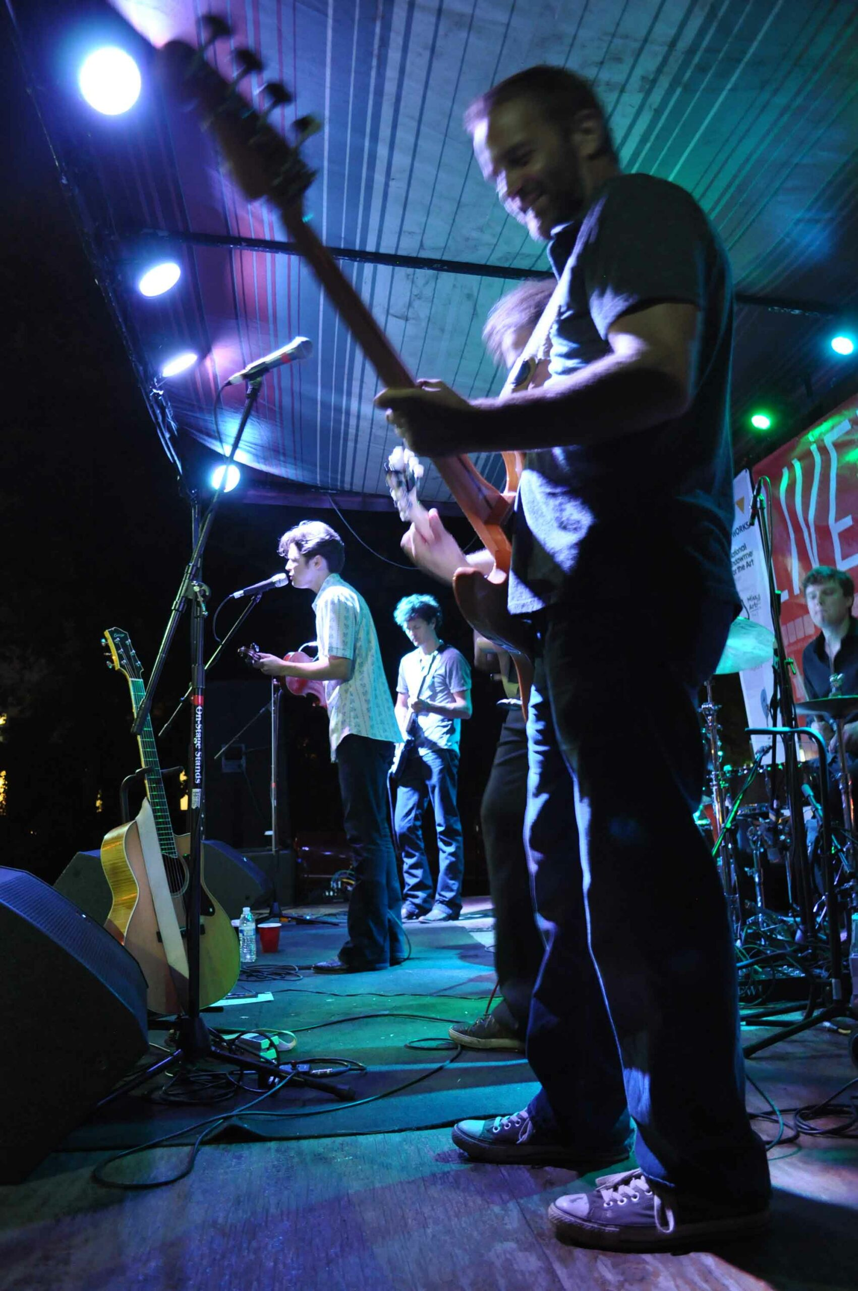A band of musicians plays on a stage