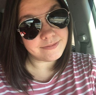 A close up of a person wearing sunglasses taking a selfieDescription automatically generated