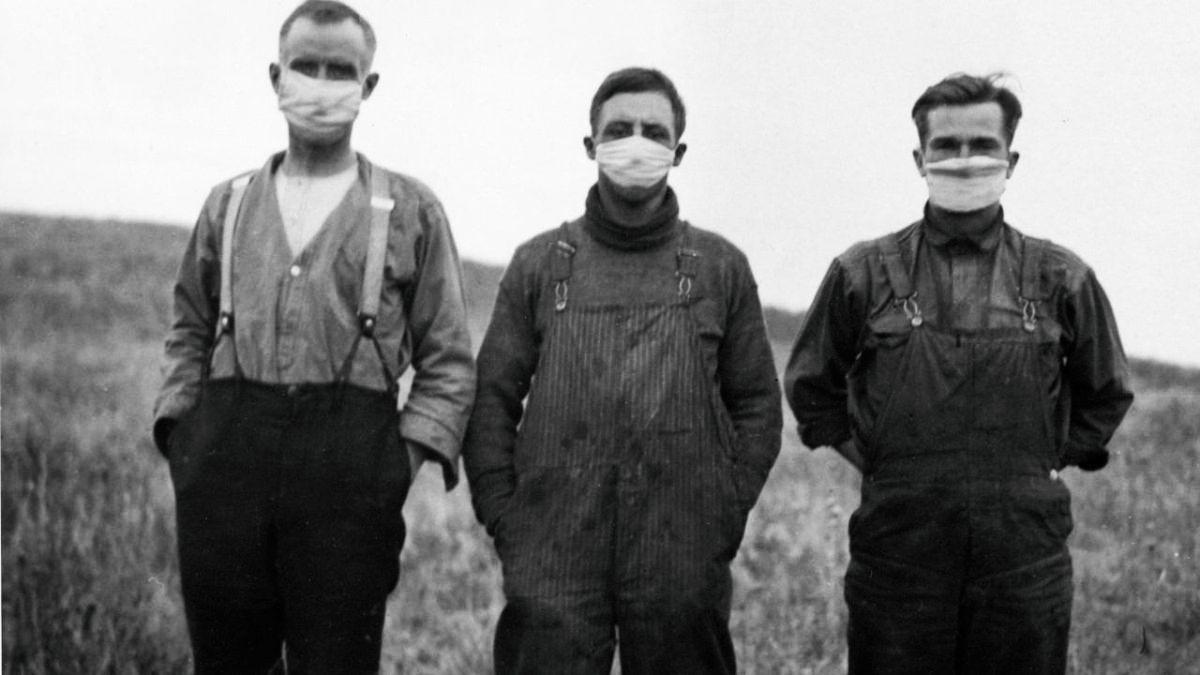 three men wearing masks