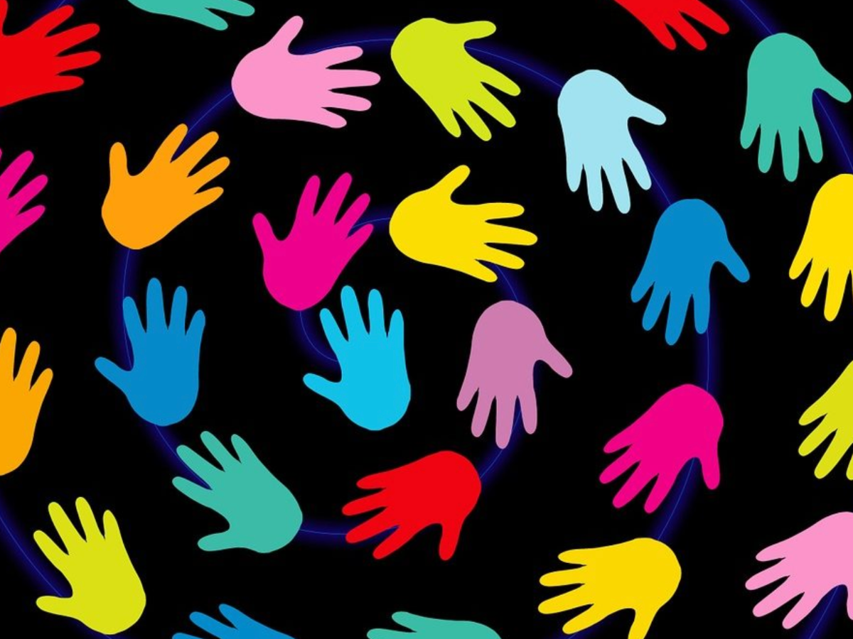 colourful hand shapes on black background
