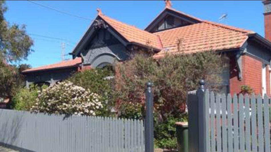 Brick house exterior with blue sky