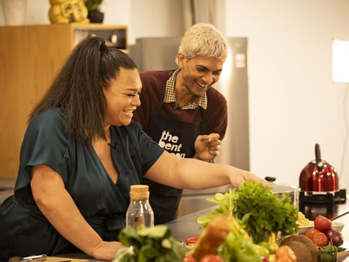 LGBTI community members at a kitchen bench with food