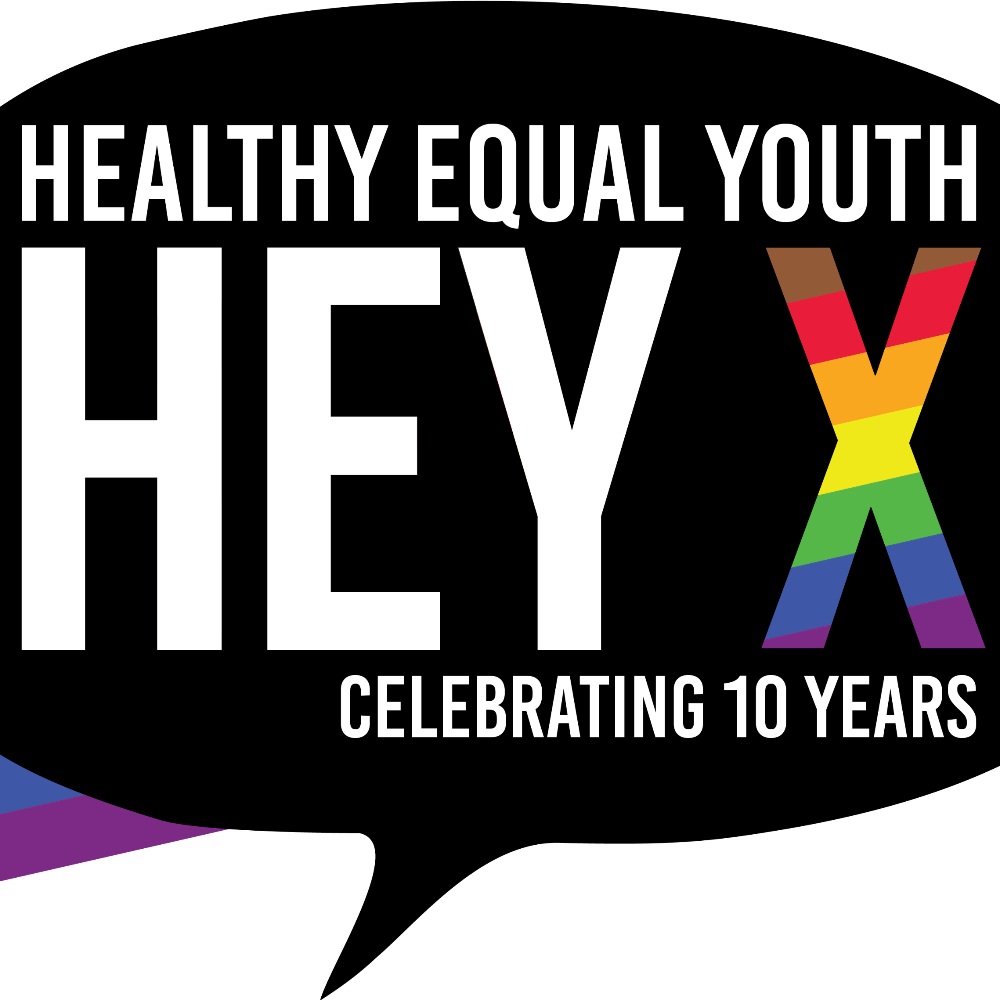 A black speech bubble logo with the words inside Healthy Equal Youth HEY. A Rainbow coloured filled X and the words celebrating 10 years.