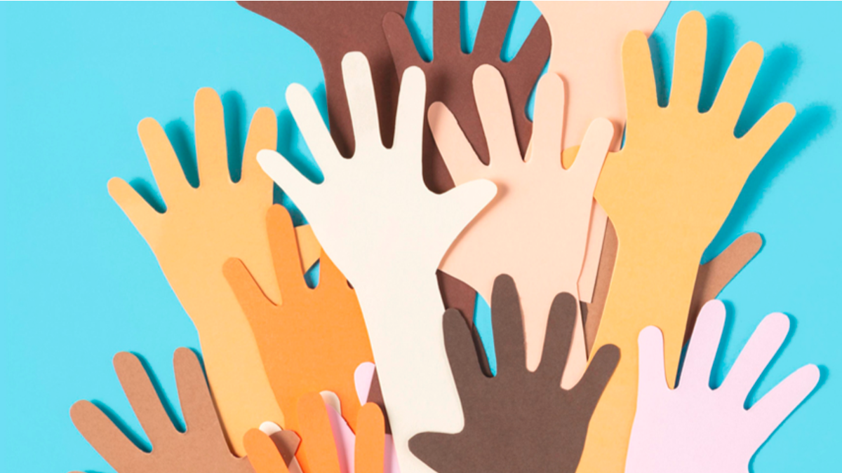many coloured hands reaching out