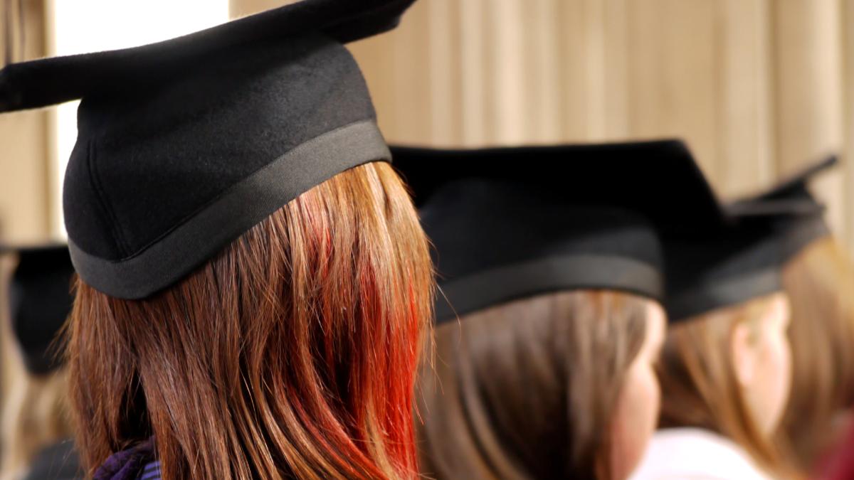 Back of university students heads wearing graduate hats