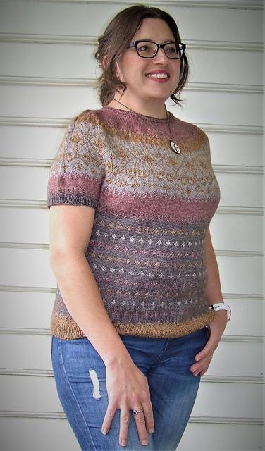 Elizabeth wears a top-down colourwork short sleeve sweater