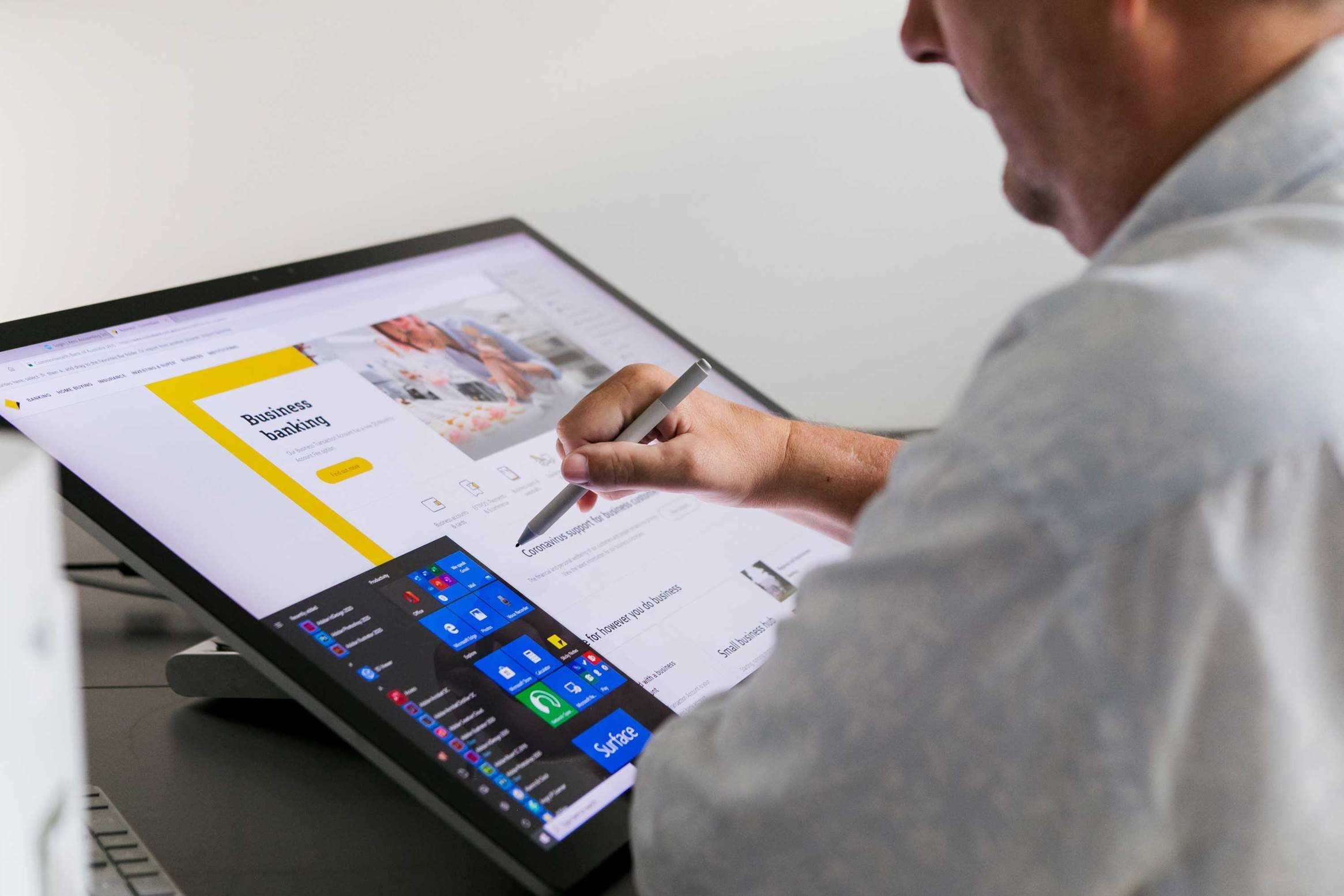 stock image of someone using a surface studio with a stylus