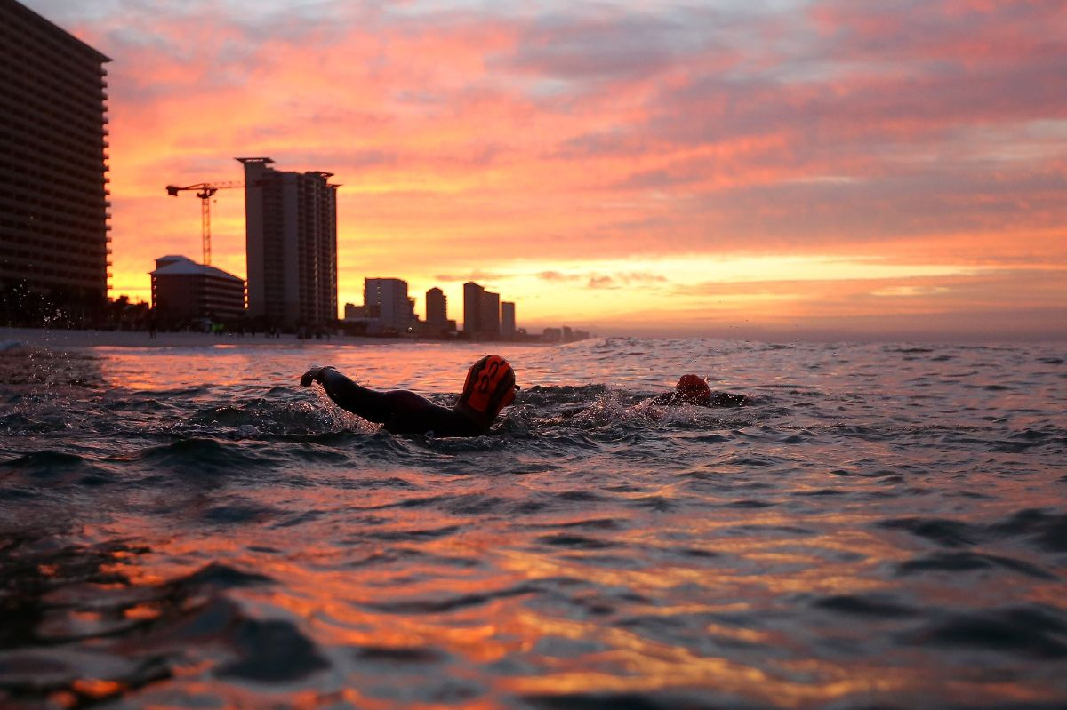 Chris swimming at sunset
