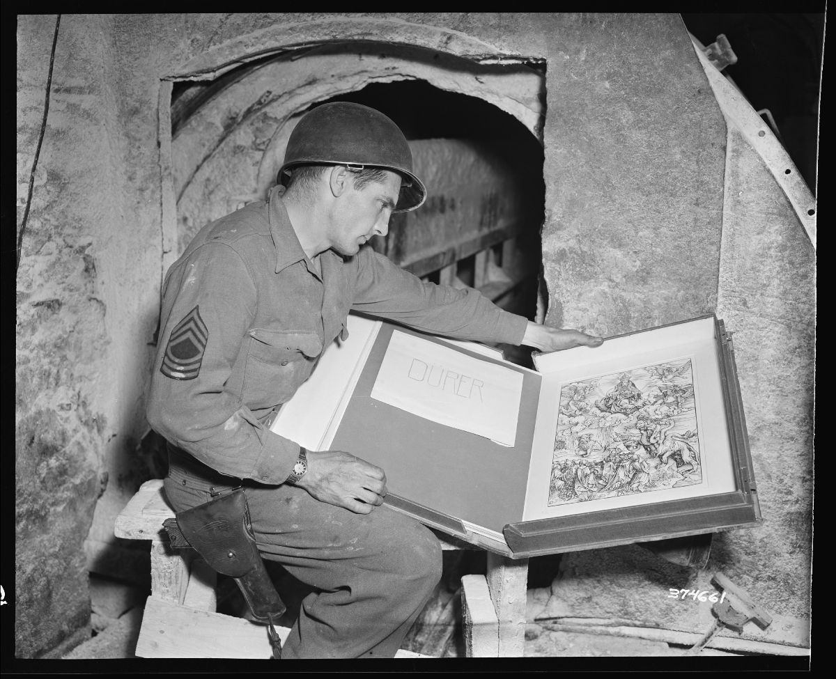 Black and white photograph of Master Sergeant Maus with an engraving found among looted art treasures, 1945