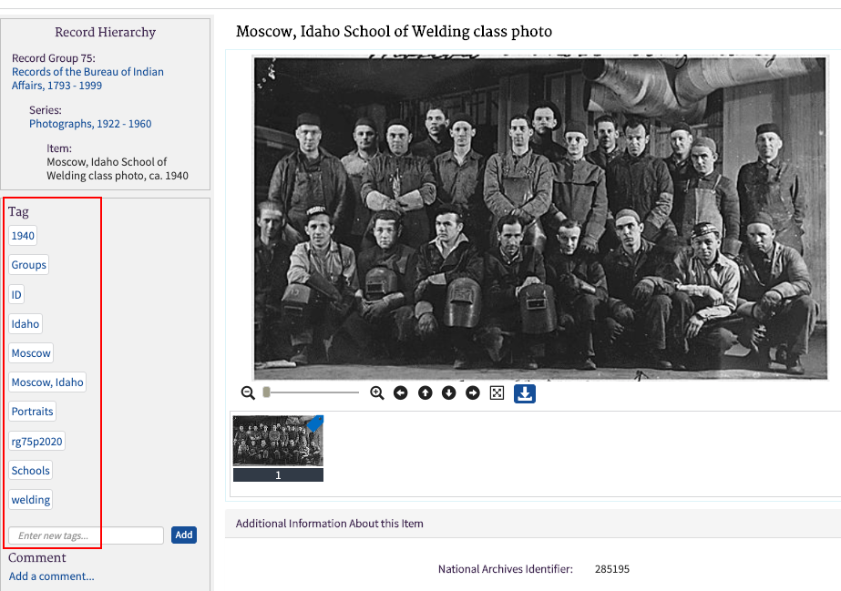Screenshot of photo from Catalog showing a group of men in a class photo. To the left of the image shows tags added to description