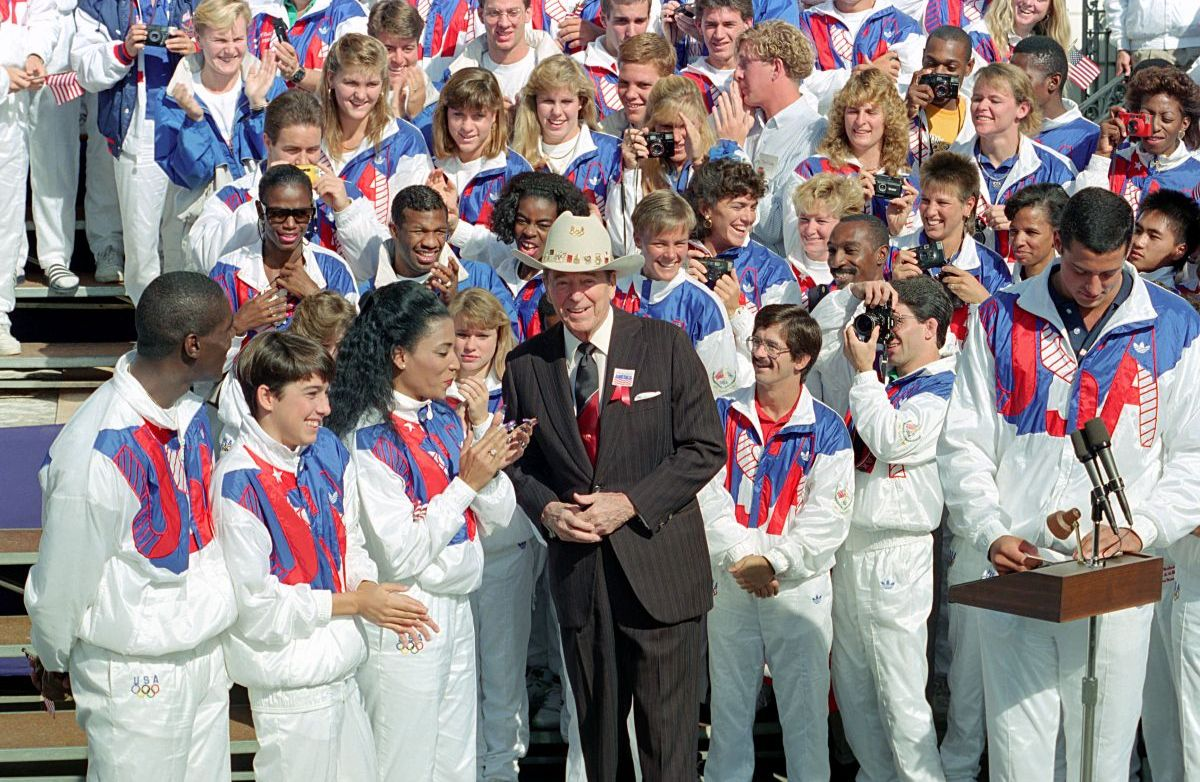 President Reagan poses with the members of the US Olympic team. President Reagan wears a cowboy hat