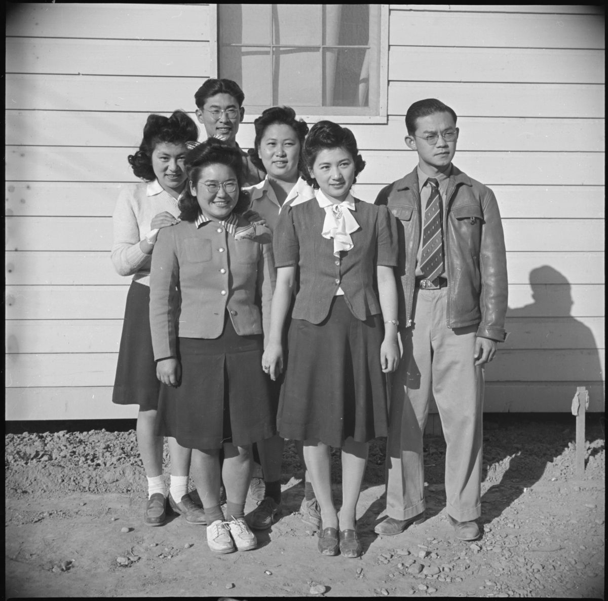 Black and white photograph of group of young Japanese Americas at Poston, Arizona war relocation center.