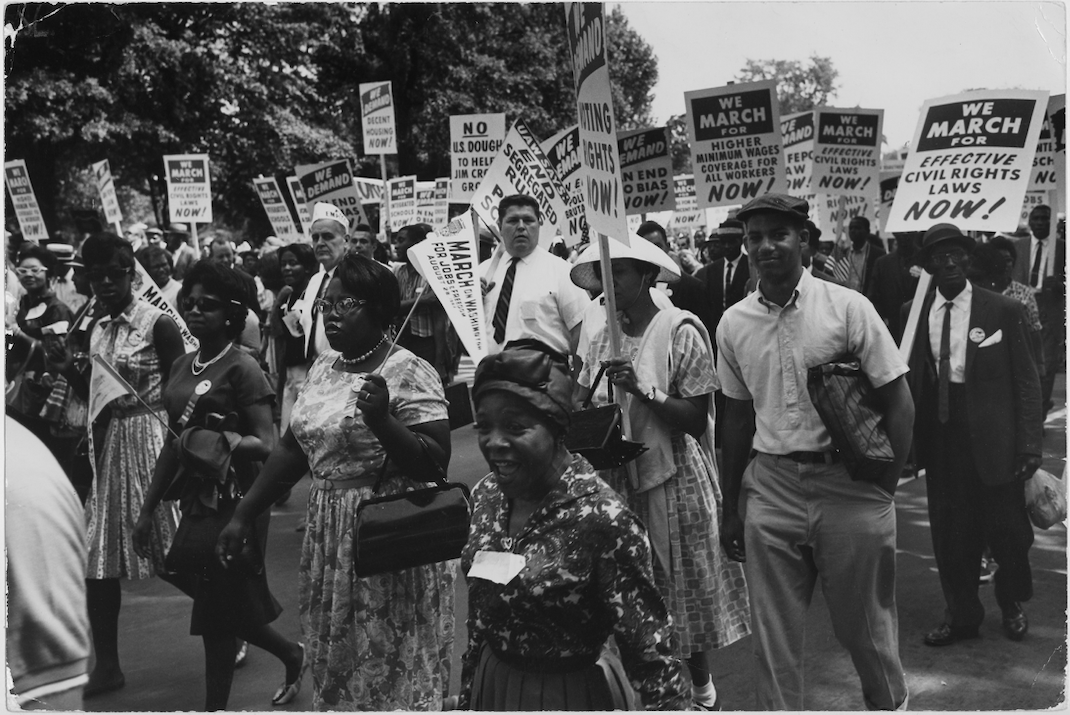 Black and white photograph of group of marchers with signs at the March on Washington, 1963