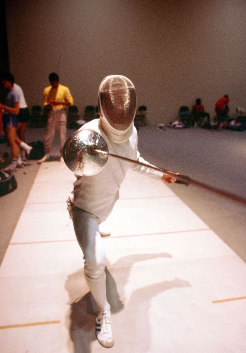 Fencing athlete pointing the sword near the direction of the camera