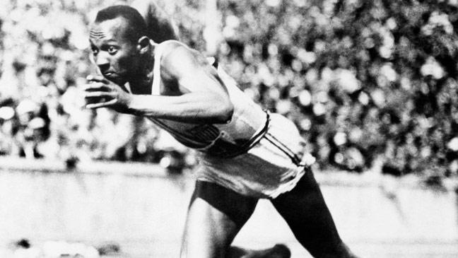 Jesse Owens breaks the 100m tape to win the first of his four gold medals at the Berlin Olympics