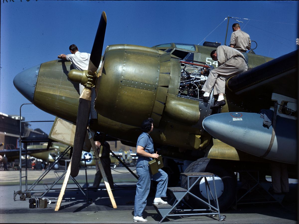 Photograph of people performing a final checkup on an aircraft