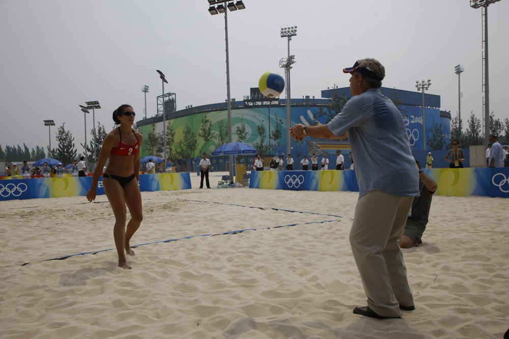 President George W Bush hits a volleyball on the beach to Misty May Treanor