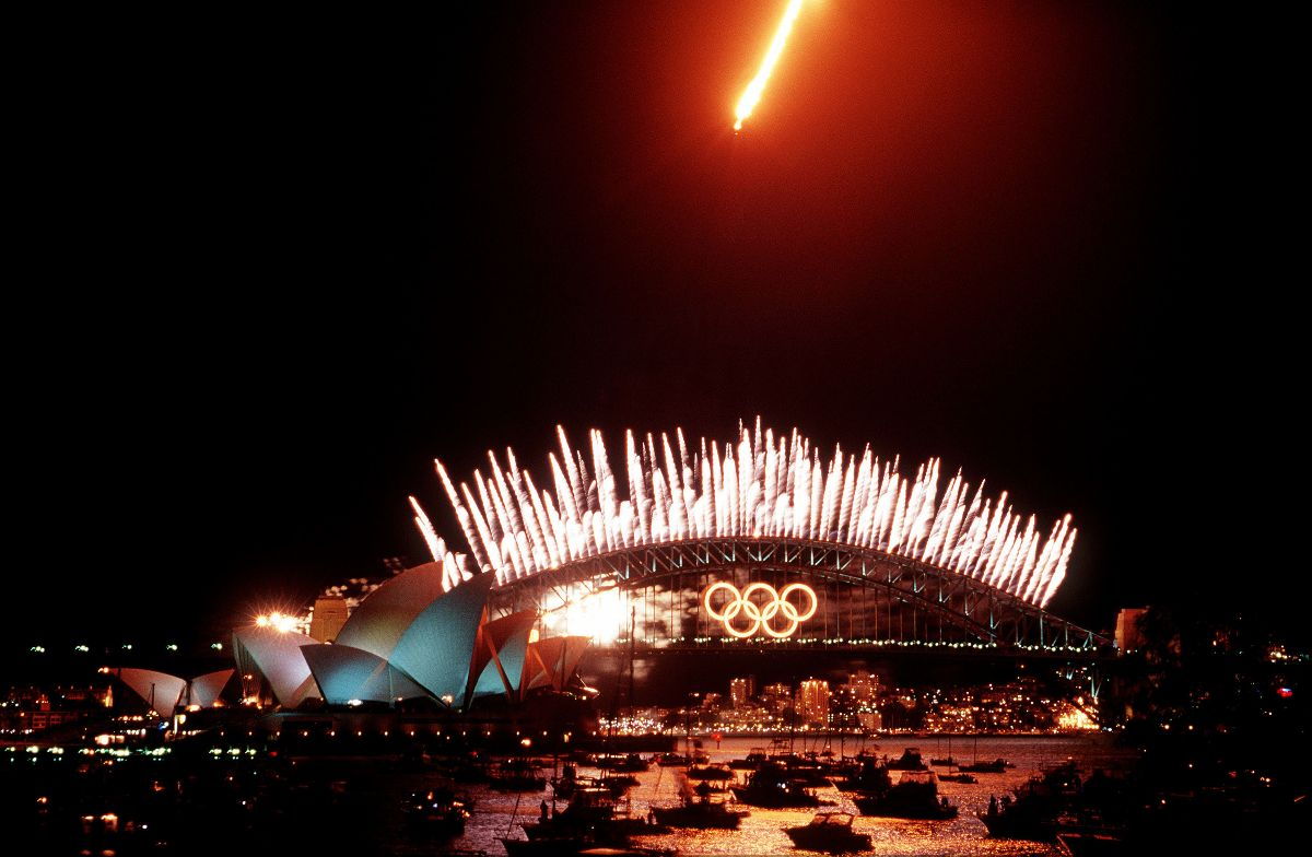 Olympic ceremonies at the Sydney Harbour Bridge. Lights and light from an aircraft are seen in the night sky over the bridge