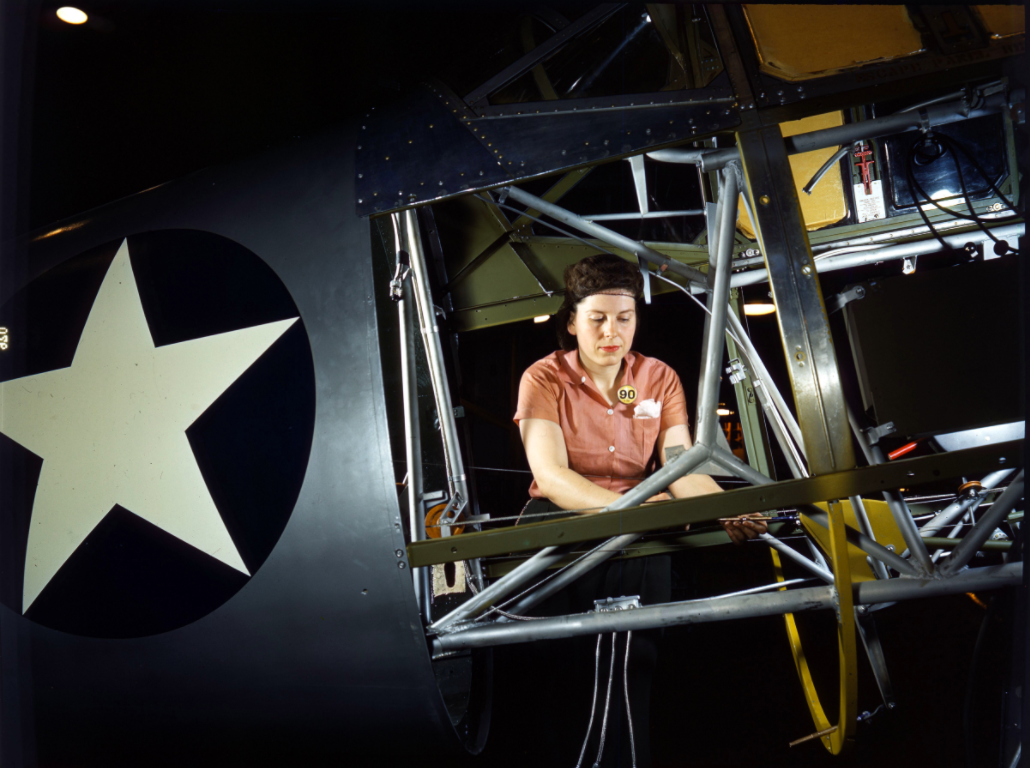 Photograph of woman working inside of SNV fuselage