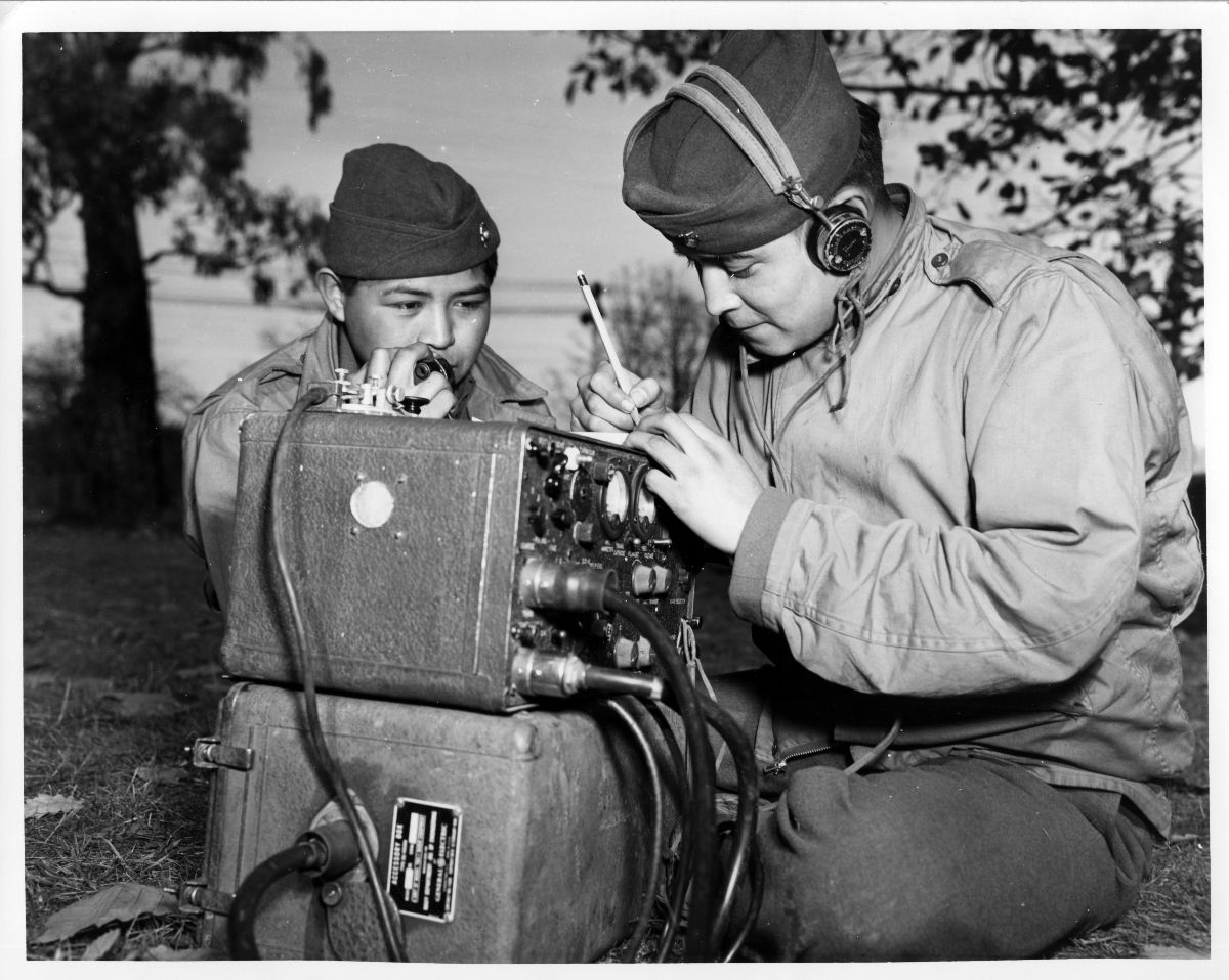 Black and white photograph of two Navajo code talkers with radio equipment